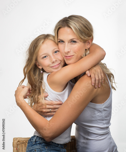 canvas print picture Beautiful blonde mother and daughter embrance each other