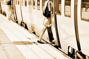 Woman enters train