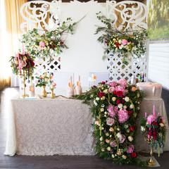 Floral arrangement to decorate the wedding feast, the bride and