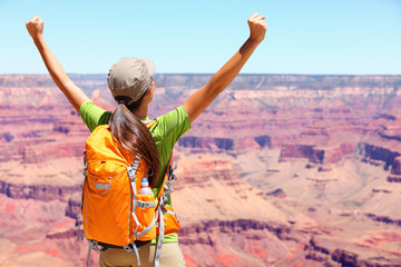 Success winner person happy hiker in Grand Canyon