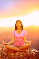 Meditating yoga woman at sunset in Grand Canyon