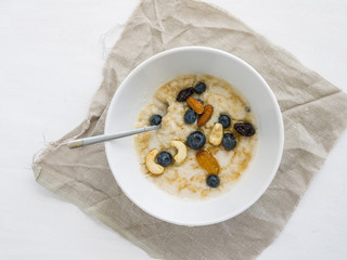 Oatmeal porridge with fresh blueberry, honey and nuts