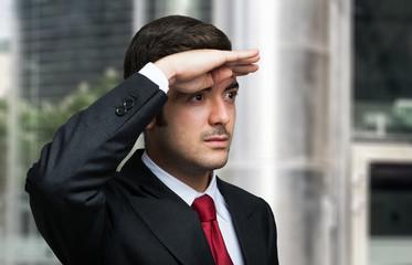 Business man looking forward