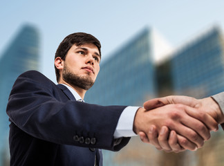 Businessman giving an handshake
