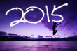 Woman jumping under number of 2015