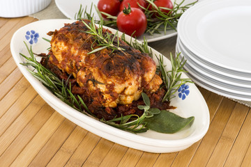 roast of veal with rosemary and tomatoes