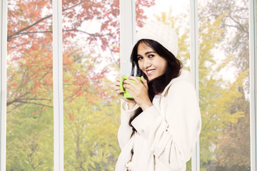Woman smiling while drinking tea