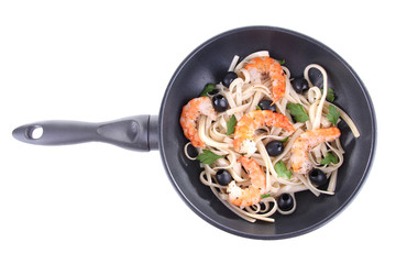 Fresh prawns with spaghetti and vegetables in a pan