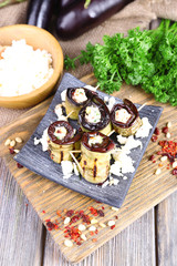 Fried aubergine with cottage cheese in a square plate