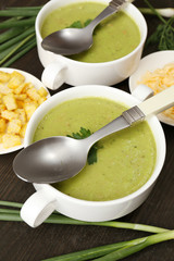 Leek soup on table, close up