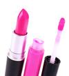 Crimson lipstick and lip gloss isolated on white