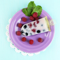 Tasty ice cream pop with fresh berries