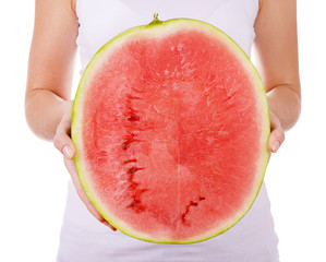 Woman holding halves of watermelon isolated on white