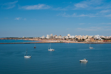 Portimao city view. Boats in the bay in sunny day