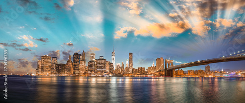 Dramatic sky over Brooklyn Bridge and Manhattan, panoramic night - 70496759