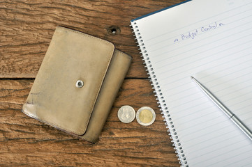 old brown wallet with budgeting plan