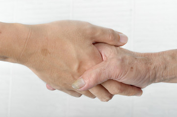 Young hand give help to old hand