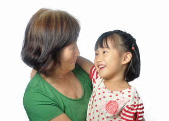 little asian granddaughter smile to her grandmother