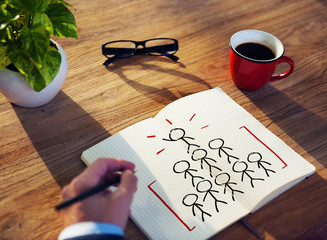 Man Writing and Planning Success Concepts