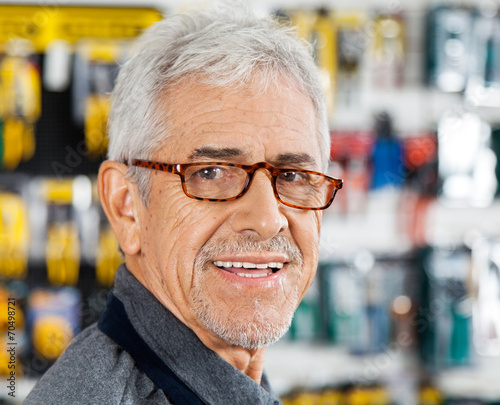 canvas print picture Salesman Smiling In Hardware Store