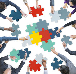 Aerial View of Business People Piecing Puzzle Pieces