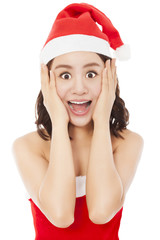 beautiful young christmas woman making a funny expression