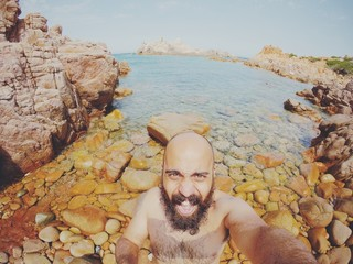 bearded man selfie in a sea landscape in summer