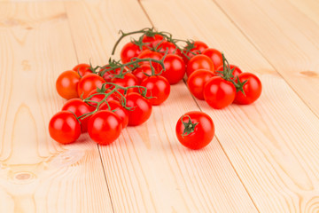 Bunch of tomatoes cherry on wood.