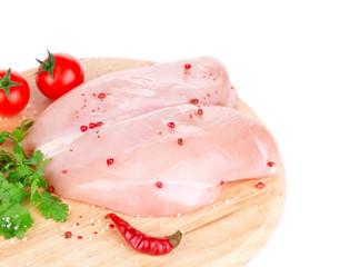 Raw chicken fillet on platter.