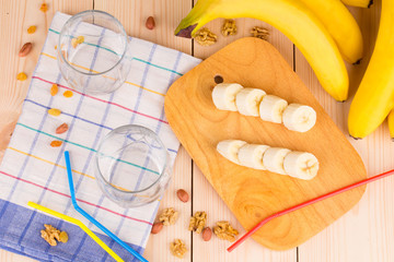 Composition of nuts and bananas on wood.