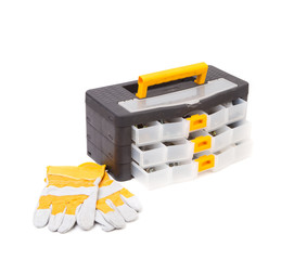Plastic tool box and leather gloves.