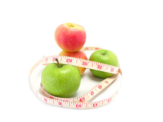 measuring tape wrapped around a green apple for diet