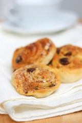 Homemade cream rolls (buns) with raisins and nuts