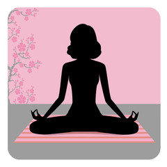 Silhouette of young woman practicing yoga