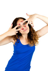Young cheerful woman looking through fingers