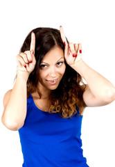 Playful  teen girl shows horns
