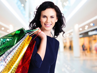 Beautiful happy woman with shopping bags.