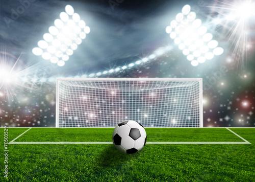 Soccer ball on green stadium arena - 70503529