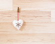 heart on wooden background, wooden clothespin