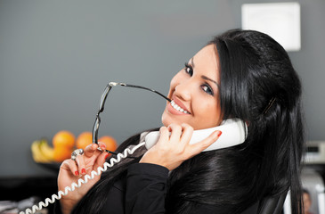 smiling female on phone