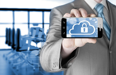 Man holds smart phone with cloud security