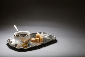 Cup of coffee on a silver tray