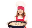 happy little girl cook hold plate with bread