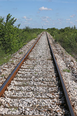 railroad tracks and blue sky with clouds landscape