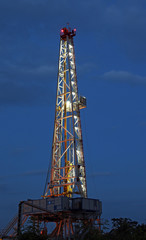 illuminated oil drilling rig on oilfield