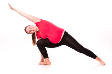 Pregnant woman exercising isolated on white