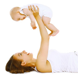 Mother holding baby, fun, exercise, leisure - concept