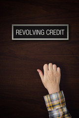 Hand is knocking on Revolving Credit door