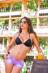 Young woman enjoying at beach bar