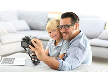 Man with little boy taking picture of themselves